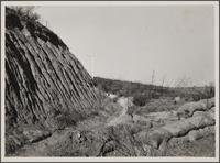 [Erosion, and cement sacks for flood control, Toulon Drive and Napoli Drive, looking north]