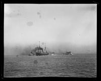Steamship transporting troops to Philippines, flanked by smaller vessels, San Francisco Bay