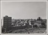 Looking south from 7th Street; parking place between Francisco and Bixel Streets, apartment house in foreground