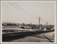 View from East Third Stand, South McDonnell Ave toward northeast on 3rd Street; autowrecking and poorest residences
