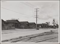 Japanese row houses, Terminal Way, Terminal Island; fishing nets in foreground
