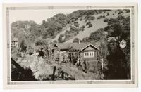 View of a ranch house built on a hillside