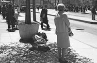 Young woman takes a nap on sidewalk on Market Street