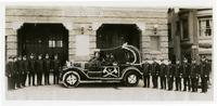 Fire fighters of Engine Co. No. 28, with car decorated with flowers for parade, Los Angeles