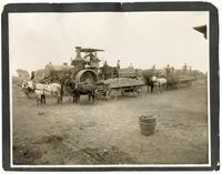 Agricultral laborers on a traction egine to haul sugar beets