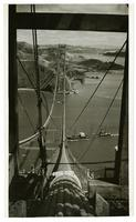View of cargo ship passing beneath Golden Gate Bridge construction