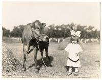 Young female child and cow