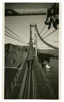 Golden Gate Bridge construction workers standing on cables