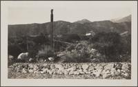 Post and low stone barrier (Haines Canyon?