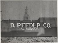 Ferry Building reflected in sign of D. PFFDLP Co., Drumm Street, San Francisco