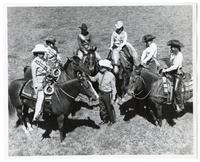 Man and horsewomen at the Hayward Rodeo
