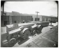 View of two sizes of Faqeol tractors at the Faqeol plant, Oakland, California, between 1910 and 1919