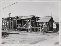 Frame of stucco house, South Fraser Avenue, north of Whittier