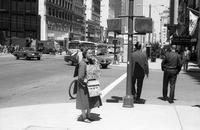 Woman with religious signs on Market Street at New Montgomery