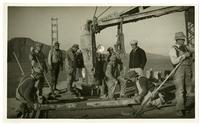 Golden Gate Bridge construction, men laying concrete
