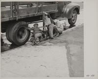 Children playing in front of truck, San Francisco