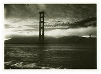 View of Golden Gate Bridge construction with fog
