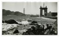 View of Golden Gate Bridge construction and Fort Point from Baker Beach