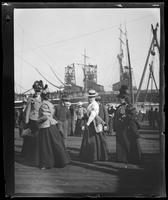 Spectators on pier, including Red Cross volunteer, as troops board ship, San Francisco Bay