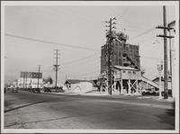 Looking north on La Brea Avenue (rock crusher on corner) from south of Romaine Street, Hollywood