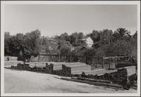 South Broadway lumber yard on east side between Evanston Place and Del Mar Boulevard, east toward orange garden