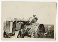 Agricultural worker operating machinery in the cotton fields, Tulare County, 1915
