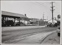 Looking northwest from Mateo and Willow Streets.; Union Oil Co. barrels