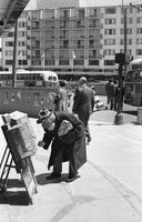 Man buying newspaper on Market Street