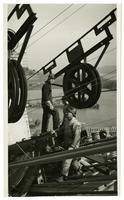 Golden Gate Bridge construction workers spinning cable