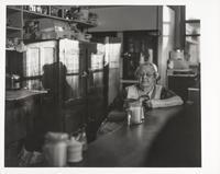 Woman reads inside cafe, San Francisco