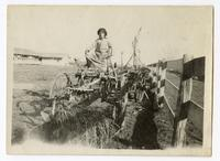 Agricultural worker operating machinery in Tulare County, 1915
