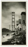 Man fishing, partial Golden Gate Bridge in background