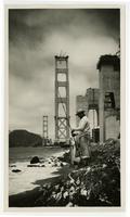 Man fishing, partial Golden Gate Bridge in background
