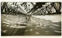 Golden Gate Bridge construction, view beneath roadway with safety netting