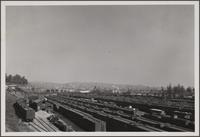 Looking north across railroad yard from cemetery opposite
