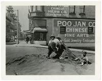Children playing with pile of sand, San Francisco Chinatown