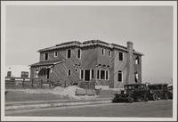 Stucco home at northwest corner of 4th and Killian Avenues