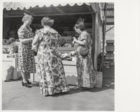 Three women at produce stand, San Francisco