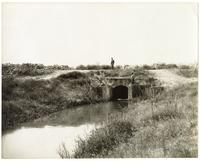 Men standing at the headgate on an irrigation ditch in San Joaquin County, California
