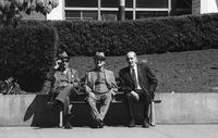 Three men on a bench in Union Square