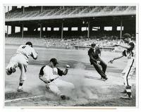 Johnny Moore of the Los Angeles Angels, sliding into third base