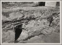 Unidentified wall ruins with tunnel openings