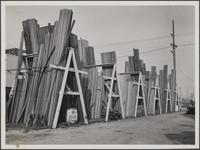 Lumber storage at southeast corner of Broadway and Jefferson Boulevard