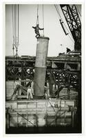 Golden Gate Bridge construction worker on concrete pillar