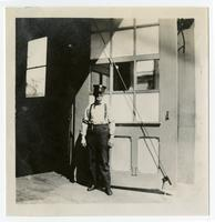 Fire fighter in front of fire house, Los Angeles