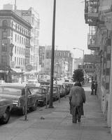 Homeless man with tattered coat (near Lafayette Hotel)