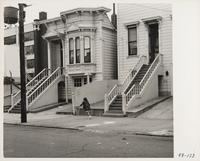 Young girl running in front of residences, San Francisco