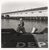 Woman fishing on the waterfront, San Francisco
