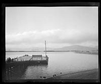 Spectators on wharf, San Francisco Bay