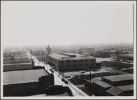 Looking south-southwest from roof of central manufacturing district (Vernon); residential town of Maywood in distance